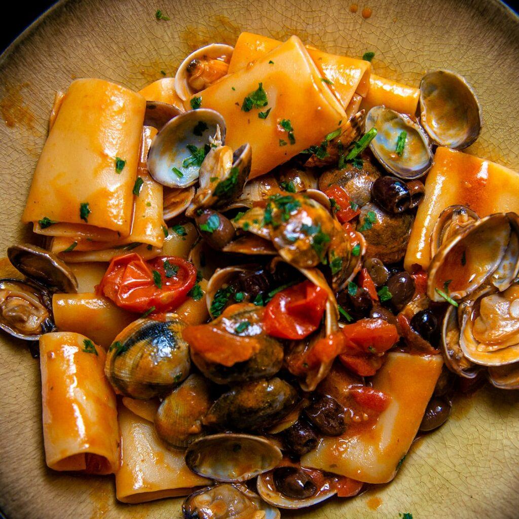 primi di pesce croce del sud pasta con vongole e pomodorini